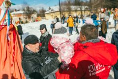 MOSCOW REGION, FRYAZINO, GREBNEVO ESTATE - MARCH 09 2019: Samy Naceri French star and actor of Taxi films piks up two. Children twins visiting the Grebnevo royalty free stock photo
