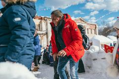 MOSCOW REGION, FRYAZINO, GREBNEVO ESTATE - MARCH 09 2019: Samy Naceri French star and actor of Taxi playing snowballs. With local kids visiting the Grebnevo royalty free stock photo