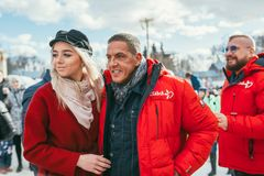 MOSCOW REGION, FRYAZINO, GREBNEVO ESTATE - MARCH 09 2019: Samy Naceri French star and actor of Taxi standing with a. Beautiful blonde fan girl visiting the stock photos