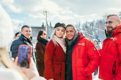 MOSCOW REGION, FRYAZINO, GREBNEVO ESTATE - MARCH 09 2019: Samy Naceri French star and actor of Taxi standing with a. Beautiful blonde fan girl visiting the stock photography