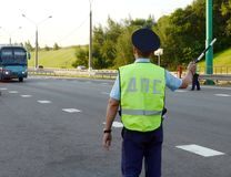 The inspector of the road police patrol stops the intercity bus for checking. Moscow Region, Russia - August 3,2017: The inspector of the road police patrol Royalty Free Stock Photos