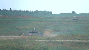 Moscow Region, Russia - August 25, 2017. Slow motion shot of moving Russian army tank stock video footage