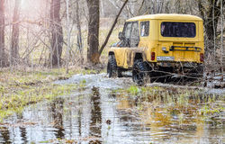 Moscow region, Russia. 04.21.2017. The sport utility vehicle SUV is driving in the forest near the town of Bronnitsy, Moscow reg Royalty Free Stock Photo
