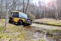 Moscow region, Russia. 04.21.2017. The sport utility vehicle SUV is driving in the forest near the town of Bronnitsy, Moscow reg Royalty Free Stock Photos