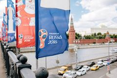 MOSCOW, RISSUA - JUNE 2018 Blue and red waving flags with the official logo and symbol of the 2018 World Cup FIFA on the stock photos