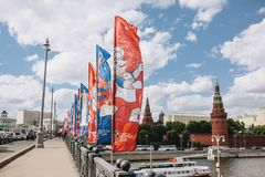 MOSCOW, RISSUA - JUNE 2018 Blue and red waving flags with the official logo and symbol of the 2018 World Cup FIFA on the. Bridge against the Kremlin royalty free stock images