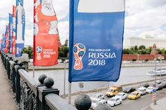 MOSCOW, RISSUA - JUNE 2018 Blue and red waving flags with the official logo and symbol of the 2018 World Cup FIFA on the. Bridge against the Kremlin stock photo