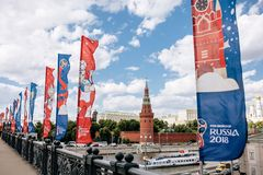 MOSCOW, RISSUA - JUNE 2018 Blue and red waving flags with the official logo and symbol of the 2018 World Cup FIFA on the. Bridge against the Kremlin stock photography