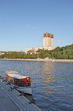 Moscow river with a boat and Russian Science Academy building. Royalty Free Stock Image
