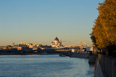 Moscow river and Church of Christ the Saviour in the sunset. A wide shot of moscow river, autumnal trees, a bridge and the Church of christ the saviour in the Royalty Free Stock Photography