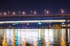 Moscow River, Luzhnetskaya Bridge & x28;Metro Bridge& x29; in the light of night colored lights. Moscow, Russia Royalty Free Stock Photography