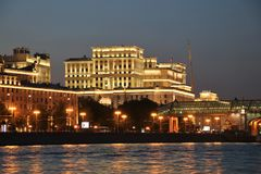 Moscow river and the Ministry of Defense at night. Moscow river and the Ministry of Defence building illuminated at night. The building was designed by Russian Royalty Free Stock Image