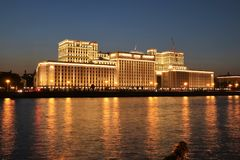Moscow river and the Ministry of Defense at night. Moscow river and the Ministry of Defence building illuminated at night. The building was designed by Russian Stock Images