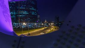 Moscow river near the skyscrapers of Moskva City district in the night timelapse view under the bridge. stock footage