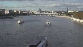 Moscow river panorama with a view on the Jesus The Savor orthodox cathedral. Moscow river cruise boats passing by