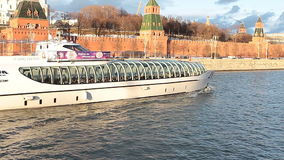Moscow river ship excursion tram near Kremlin stock video footage