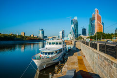 Moscow river, white boat and International Business Center tower Stock Images