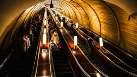 Moscow, Russa - February 22, 2015: Deep subway station is crowded with people riding the escalators down royalty free stock photos