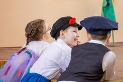 MOSCOW, RUSSI - MAY 06, 2018: Smiling children in carnival or concert costumes gossiping royalty free stock photo