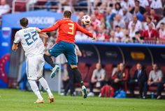Spain national football team centre-back Gerard Pique against Russia national team striker Artem Dzyuba. Moscow, Russia – July 1, 2018. Spain national royalty free stock photo