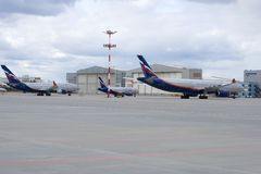 Aeroflot passenger aircrafts at Sheremetyevo Airport. MOSCOW, RUSSIA - APRIL 15, 2015: Aeroflot passenger aircrafts at Sheremetyevo Airport Royalty Free Stock Image