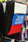 MOSCOW, RUSSIA - April 21, 2018: Back pack laptop bag in a gift shop with World Cup FIFA 2018 mundial symbols. Souvenir store. National russian flag Stock Photography
