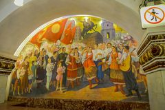 MOSCOW, RUSSIA- APRIL, 29, 2018: Beautiful indoor view of mosaic art in the wall at Kievskaya Metro Station, in Moscow. Russia royalty free stock photos