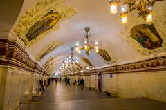 MOSCOW, RUSSIA- APRIL, 29, 2018: Beautiful indoor view of people in Kievskaya Metro Station in Moscow. It is on the. Koltsevaya Line, between Park Kultury and Stock Photography