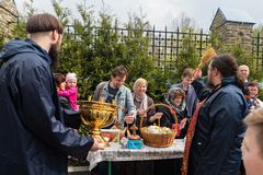 Priest consecrates Easter eggs and Easter cakes on the eve of Easter stock photos