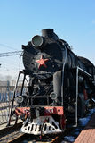 Moscow, Russia - April 1.2017. Black old locomotive in Museum of History of Railway Transport Development. Moscow, Russia - April 1.2017. Black old locomotive in stock photo