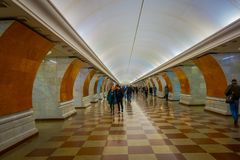 MOSCOW, RUSSIA- APRIL, 29, 2018: Blurred indoor view of people walking inside of Beautifully decorated metro station in. Moscow Russia Royalty Free Stock Photography