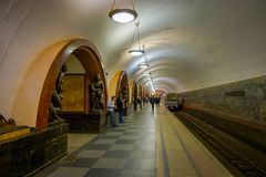 MOSCOW, RUSSIA- APRIL, 29, 2018: The bronze sculpture inside of Ploshchad Revolyutsii subway station. In Moscow Russia Royalty Free Stock Photography