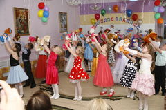 Moscow, Russia-April 17, 2014:children dancing and playing during a party in kindergarte Stock Image