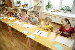 MOSCOW, RUSSIA-APRIL 17, 2014: children play with toys in a kindergarten Royalty Free Stock Image