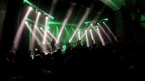Crowd of fans cheering live rock concert stock video