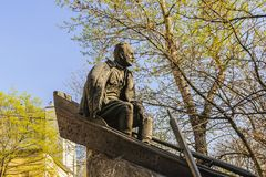 Moscow, Russia-April, 28, 2015: Fragment of the bronze monument to the Russian Soviet writer Mikhail Sholokhov. Gogol Boulevard royalty free stock photography