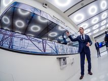 Huawei Russia manager presents demo stand Smart Grid. MOSCOW, RUSSIA - APRIL 3, 2018: Huawei Russia manager presents demo stand Smart Grid at event opening Stock Photo