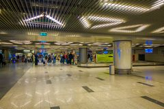 MOSCOW, RUSSIA- APRIL, 24, 2018: Indoor view of blurred passengers walking and waiting for the departure in the huge. Waiting hall of the international airport Royalty Free Stock Images
