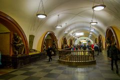 MOSCOW, RUSSIA- APRIL, 29, 2018: Indoor view of unidentified people walking close to the bronze sculpture in Ploshchad. Revolyutsii subway station in Moscow Stock Photo