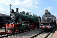 Old Soviet locomotives in the Museum of the history of railway transport at the Riga station in Moscow. MOSCOW, RUSSIA - APRIL 20, 2016: Old Soviet locomotives stock photography