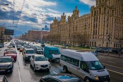 MOSCOW, RUSSIA- APRIL, 29, 2018: Outdoor view of heavy traffic from Lubyanka Square with hundreds of cars, in a gorgeous. Cloudy day in dowtown of the city of Royalty Free Stock Image