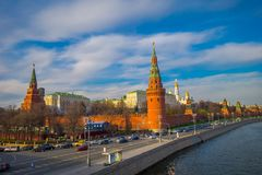 MOSCOW, RUSSIA- APRIL, 24, 2018: Outdoor view of Spasskaya tower located in a river side with some traffic during a. Sunny day with Kremlin wall, in Moscow stock image