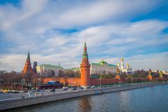 MOSCOW, RUSSIA- APRIL, 24, 2018: Outdoor view of Spasskaya tower located in a river side with some traffic during a. Sunny day with Kremlin wall, in Moscow royalty free stock photos