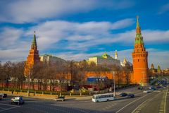 MOSCOW, RUSSIA- APRIL, 24, 2018: Outdoor view of Spasskaya tower with some traffic in the streets, during a sunny day. With Kremlin wall in Moscow Russia royalty free stock images