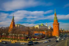 MOSCOW, RUSSIA- APRIL, 24, 2018: Outdoor view of Spasskaya tower with some traffic in the streets, during a sunny day. With Kremlin wall in Moscow Russia royalty free stock image