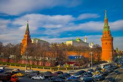MOSCOW, RUSSIA- APRIL, 24, 2018: Outdoor view of Spasskaya tower with some traffic in the streets, during a sunny day. With Kremlin wall in Moscow Russia stock photography