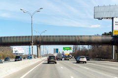 Moscow, Russia -  April 08.2016. Overhead footbridge crossing over Moscow Ring Road. Stock Photo