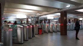 Moscow, Russia - April 14. 2018. People enter metro through turnstiles at Komsomolskaya station. Moscow, Russia - April 14. 2018. People enter the metro through stock video footage