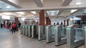 Moscow, Russia - April 14. 2018. People enter metro through turnstiles at Komsomolskaya station. Moscow, Russia - April 14. 2018. People enter the metro through stock video