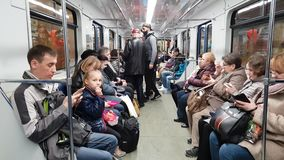 Moscow, Russia - April 14. 2018. people ride in subway car. Moscow, Russia - April 14. 2018. people ride in a subway car stock footage